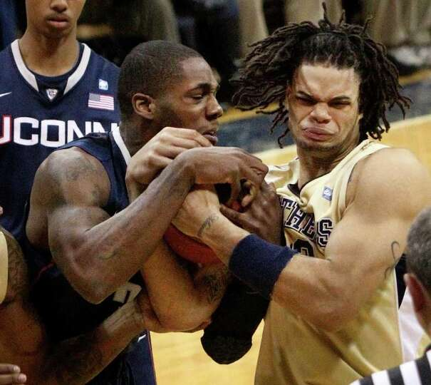 UConn's Alex Oriakhi tussles for a rebound with Pittsburgh's Gary McGhee last season on Dec. 27, 201