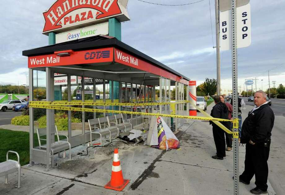 Significant damage is seen at the CDTA kiosk after an early morning accident on Central Avenue in front of the Hannaford Plaza in Albany, N.Y. October 18, 2011.    (Skip Dickstein / Times Union) Photo: SKIP DICKSTEIN / 2011