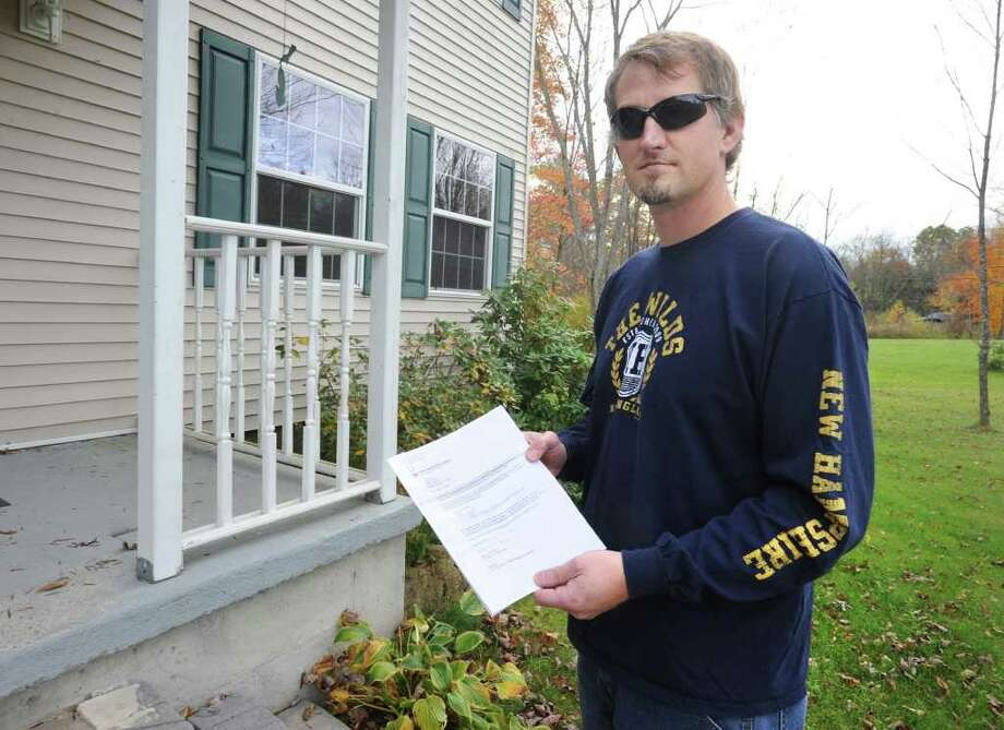 Mark Walkowicz holds a letter from Time Warner Cababout difficulty getting cable at his house., N.Y. Tuesday, Oct. 18, 2011. (Lori Van Buren / Times Union) Photo: Lori Van Buren
