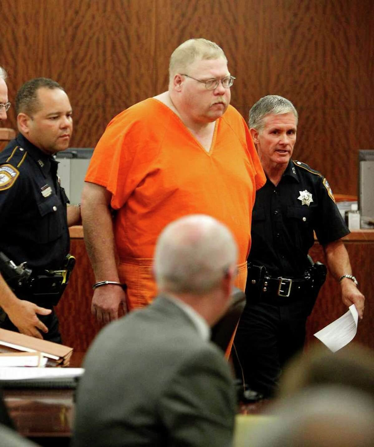 Steven Alexander Hobbs, 40 of Crosby is lead away from the bench in court at the Harris County Criminal Courthouse, Wednesday, Oct. 19, 2011. Hobbs was accused of attacking prostitutes has been charged with capital murder after DNA evidence allegedly linked him to a 2010 killing. ( Karen Warren / Houston Chronicle )