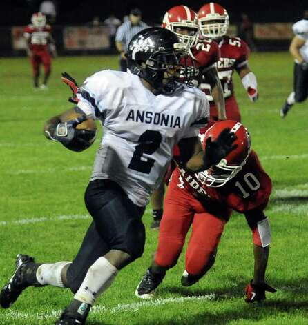 Ansonia's Arkeel Newsome rushes for yardage against host Derby on Sept 30, 2011. Photo: Christian Abraham, Christian Abraham/Staff Photographer / Connecticut Post