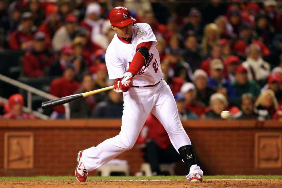 Allen Craig #21 of the St. Louis Cardinals hits an RBI single in the bottom of the sixth inning during Game One of the MLB World Series against the Texas Rangers at Busch Stadium on October 19, 2011 in St Louis, Missouri. Photo: Dilip Vishwanat, Getty / 2011 Getty Images