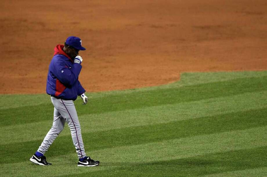 Manager Ron Washington of the Texas Rangers walks to the mound in the bottom of the sixth inning during Game One of the MLB World Series against the St. Louis Cardinals at Busch Stadium on October 19, 2011 in St Louis, Missouri. Photo: Doug Pensinger, Getty / 2011 Getty Images