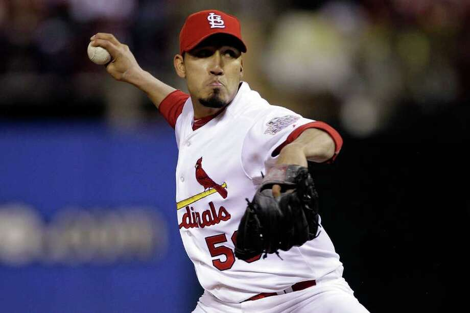 Fernando Salas #59 of the St. Louis Cardinals pitches in the top of the seventh inning during Game One of the MLB World Series against the Texas Rangers at Busch Stadium on October 19, 2011 in St Louis, Missouri. Photo: Rob Carr, Getty / 2011 Getty Images