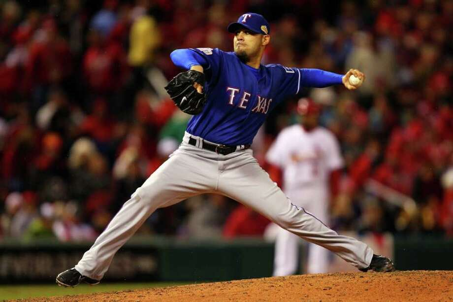 Mike Gonzalez #51 of the Texas Rangers pitches in the bottom of the seventh inning during Game One of the MLB World Series against the St. Louis Cardinals at Busch Stadium on October 19, 2011 in St Louis, Missouri. Photo: Dilip Vishwanat, Getty / 2011 Getty Images