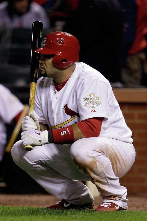 Albert Pujols #5 of the St. Louis Cardinals awaits to bat in the bottom of the seventh inning during Game One of the MLB World Series against the Texas Rangers at Busch Stadium on October 19, 2011 in St Louis, Missouri. Photo: Rob Carr, Getty / 2011 Getty Images