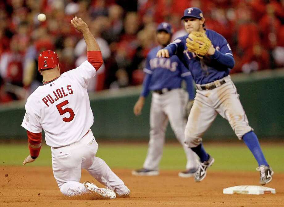 St. Louis Cardinals' Albert Pujols (5) is forced out at second base by Texas Rangers infielder Ian Kinsler in Game 1 of the World Series at Busch Stadium in St. Louis, Missouri, on Wednesday, October 19, 2011. (Ron Jenkins/Fort Worth Star-Telegram/MCT) Photo: Ron Jenkins, McClatchy-Tribune News Service / Fort Worth Star-Telegram