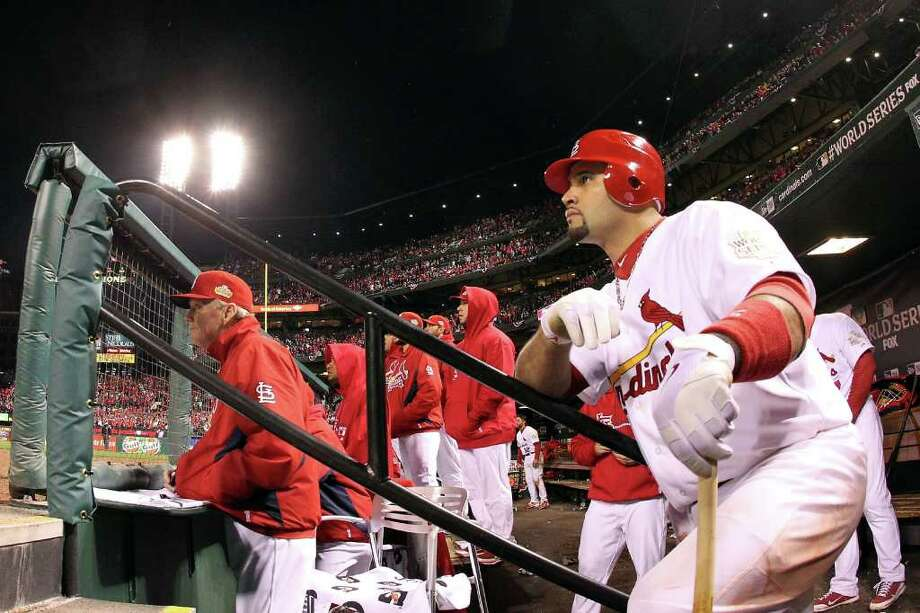 Albert Pujols #5 of the St. Louis Cardinals looks on from the dugout during Game One of the MLB World Series against the Texas Rangers at Busch Stadium on October 19, 2011 in St Louis, Missouri. Photo: Dilip Vishwanat, Getty / 2011 Getty Images