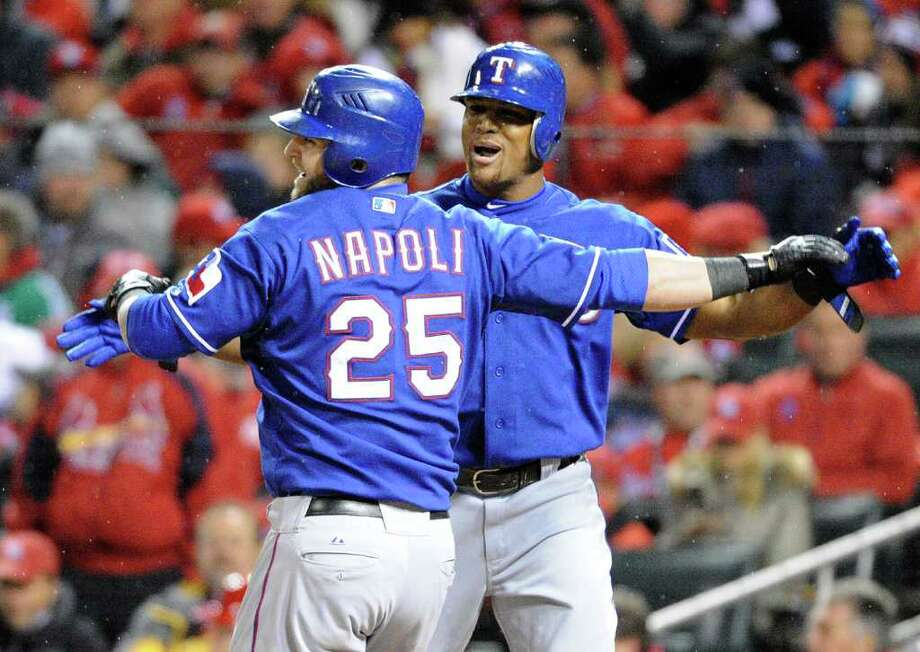 Texas Rangers' Mike Napoli and Adrian Beltre celebrate after Napoli's two-run home run in the fifth inning against the St. Louis Cardinals in Game 1 of the World Series at Busch Stadium in St. Louis, Missouri, on Wednesday, October 19, 2011. (Max Faulkner/Fort Worth Star-Telegram/MCT) Photo: Max Faulkner, McClatchy-Tribune News Service / Fort Worth Star-Telegram