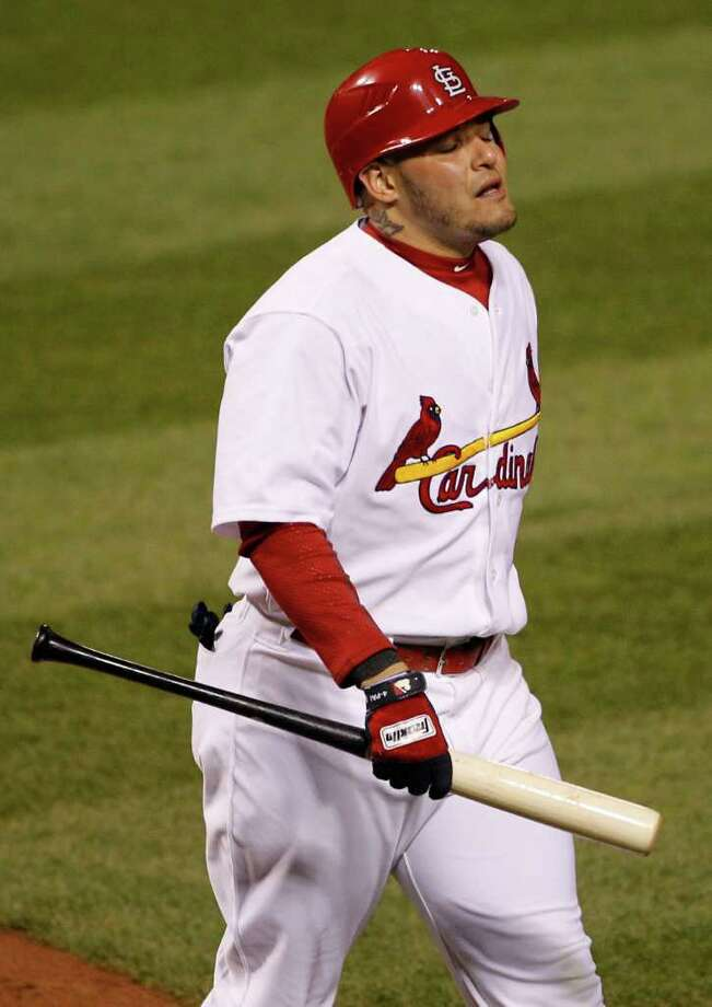 St. Louis Cardinals' Yadier Molina reacts after striking out during the sixth inning of Game 1 of baseball's World Series against the Texas Rangers Wednesday, Oct. 19, 2011, in St. Louis. (AP Photo/Eric Gay) Photo: Eric Gay, Associated Press / AP