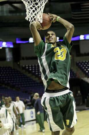 Siena's Edwin Ubiles dunks during practice at the NCAA 2010 Basketball Championships at Spokane Arena in Spokane, Wash., Thursday, March 18, 2010. (Rajah Bose / Speical to the Times Union)