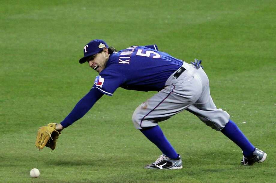 Ian Kinsler #5 of the Texas Rangers reaches for an infield single in the eighth inning during Game One of the MLB World Series against the St. Louis Cardinals at Busch Stadium on October 19, 2011 in St Louis, Missouri. Photo: Ezra Shaw, Getty / 2011 Getty Images
