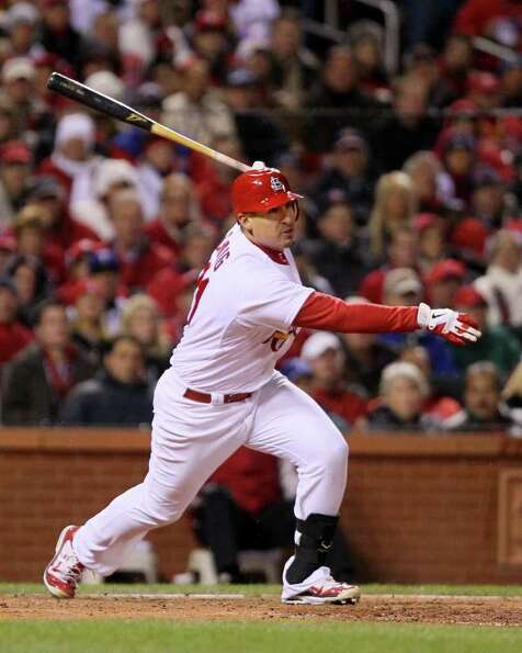 The St. Louis Cardinals' Allen Craig singles in the sixth inning to score David Freese against the T
