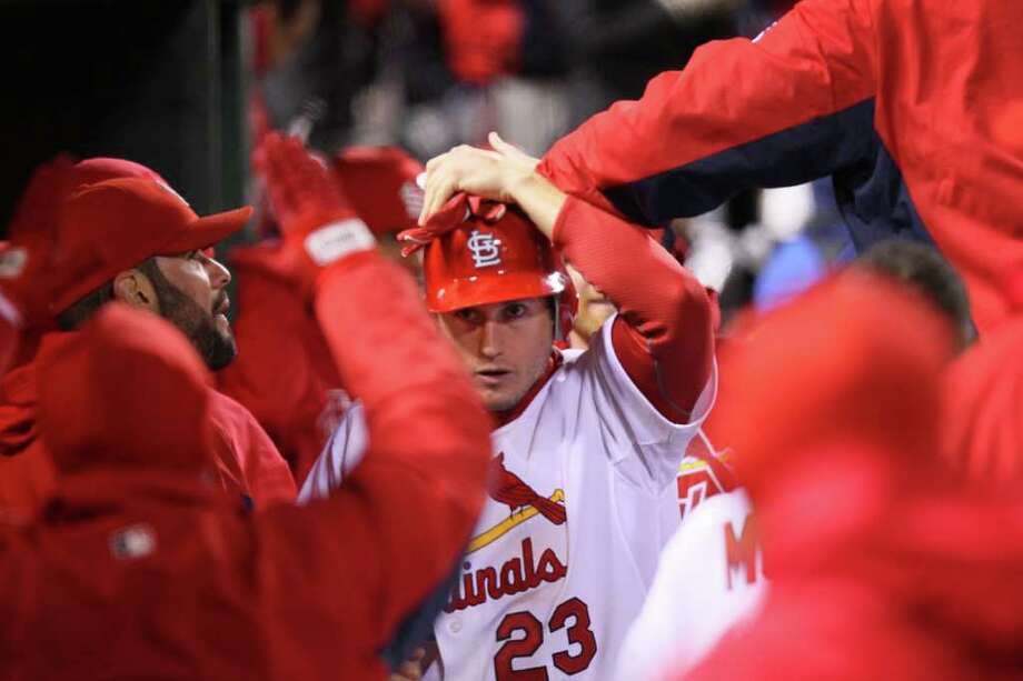 The St. Louis Cardinals' David Freese is congratulated by teammates in the sixth inning after he scored on a pinch-hit single by Allen Craig against the Texas Rangers in Game 1 of the World Series at Busch Stadium in St. Louis, Missouri, on Wednesday, October 19, 2011. (Chris Lee/St. Louis Post-Dispatch/MCT) Photo: Chris Lee, McClatchy-Tribune News Service / St. Louis Post-Dispatch