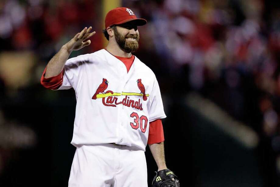 Game 1: Cardinals 3, Rangers 2 (Cardinals lead series 1-0) - Cardinals closer Jason Motte celebrates after getting the last out of the ninth inning to defeat the Texas Rangers 3-2 during Game 1 Wednesday night in St Louis. Photo: Rob Carr, Getty / 2011 Getty Images
