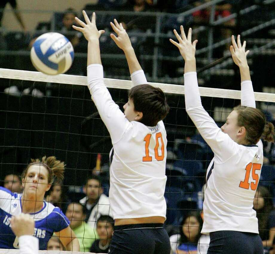 UTSA's McKenzie Adams, middle, and Whitney Walls defend the net during a Southland Conference college volleyball game against Texas A&M-Corpus Christi, Wednesday, Oct. 19, 2011, at UTSA. Photo: Darren Abate, Darren Abate/Special To The Express-News