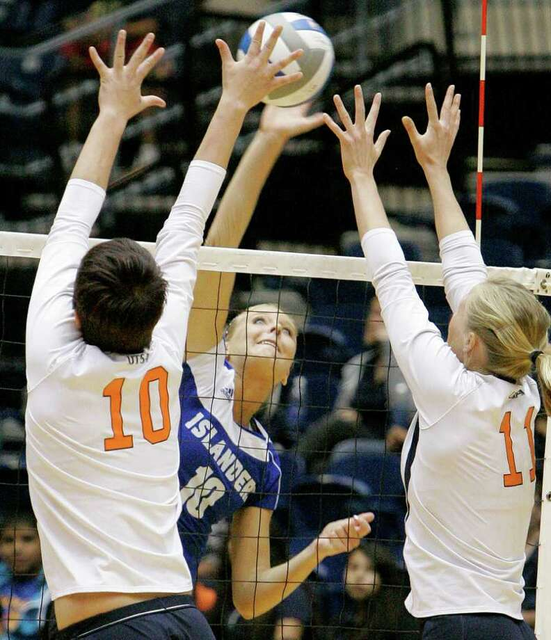 UTSA's McKenzie Adams, left, and Kelsey Schwirtlich, right, defend against Texas A&M-Corpus Christi's Brianna Brink during a Southland Conference college volleyball game, Wednesday, Oct. 19, 2011, at UTSA. Photo: Darren Abate, Darren Abate/Special To The Express-News