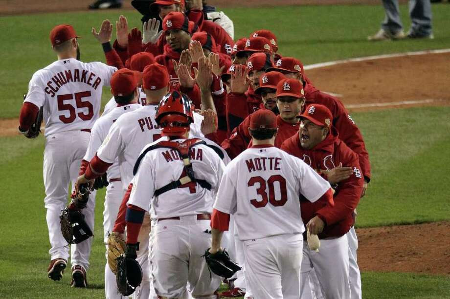 The St. Louis Cardinals celebrate after defeating the Texas Rangers 3-2 during Game One of the MLB World Series at Busch Stadium on October 19, 2011 in St Louis, Missouri. Photo: Jamie Squire, Getty / 2011 Getty Images