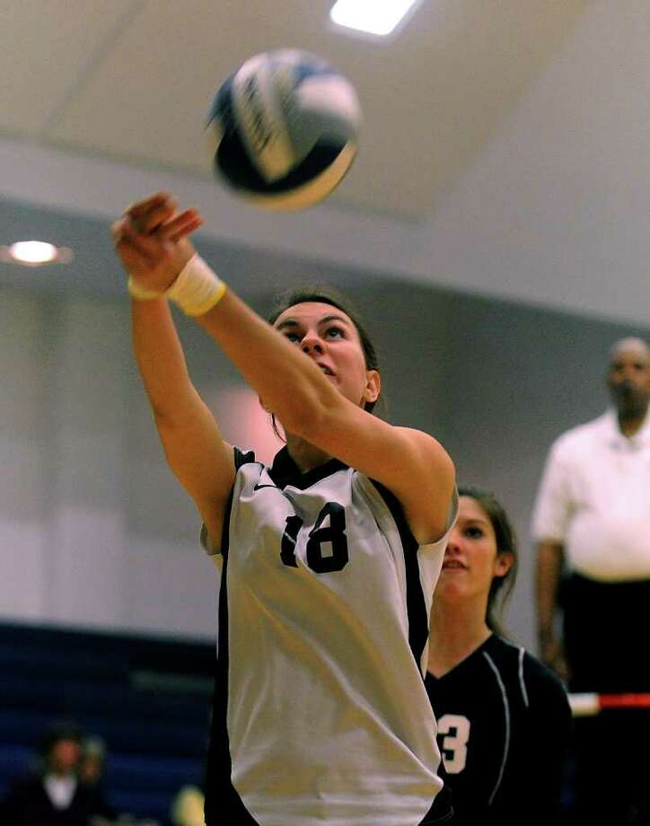 Pomperaug's #18 Sarah Theriault bumps the ball during girls volleyball action against Weston in Weston, Conn. on Wednesday October 19, 2011. Photo: Christian Abraham / Connecticut Post