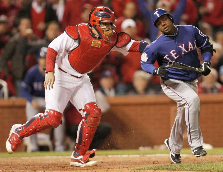 RON JENKINS : FORT WORTH STAR-TELEGRAM QUICK TAG: Cardinals catcher Yadier Molina tags Rangers second baseman Esteban German for the third out with two runners on in the top of the seventh inning. Photo: Ron Jenkins / Fort Worth Star-Telegram