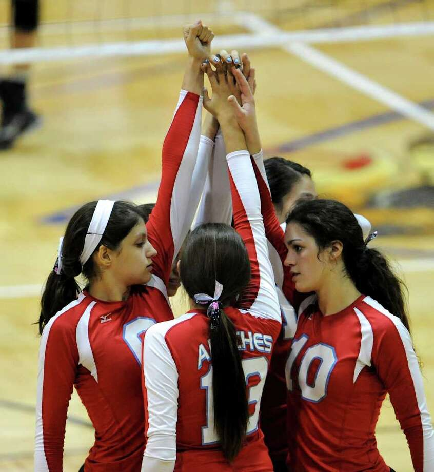 The Antonian Apaches gather on the court before their match against the  Incarnate Word Shamrocks TAPPS 5A volleyball match at Greehey Arena in San Antonio, Texas on October 19, 2011.