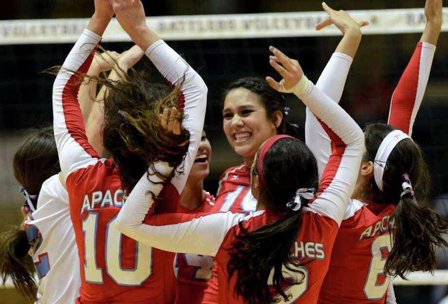 Antonian's Jordan Ruiz (15) is congratulated by her teammates after recording a kill during the Antonian Apaches and Incarnate Word Shamrocks TAPPS 5A volleyball match at Greehey Arena in San Antonio, Texas on October 19, 2011. John Albright / Special to the Express-News. Photo: Express-News