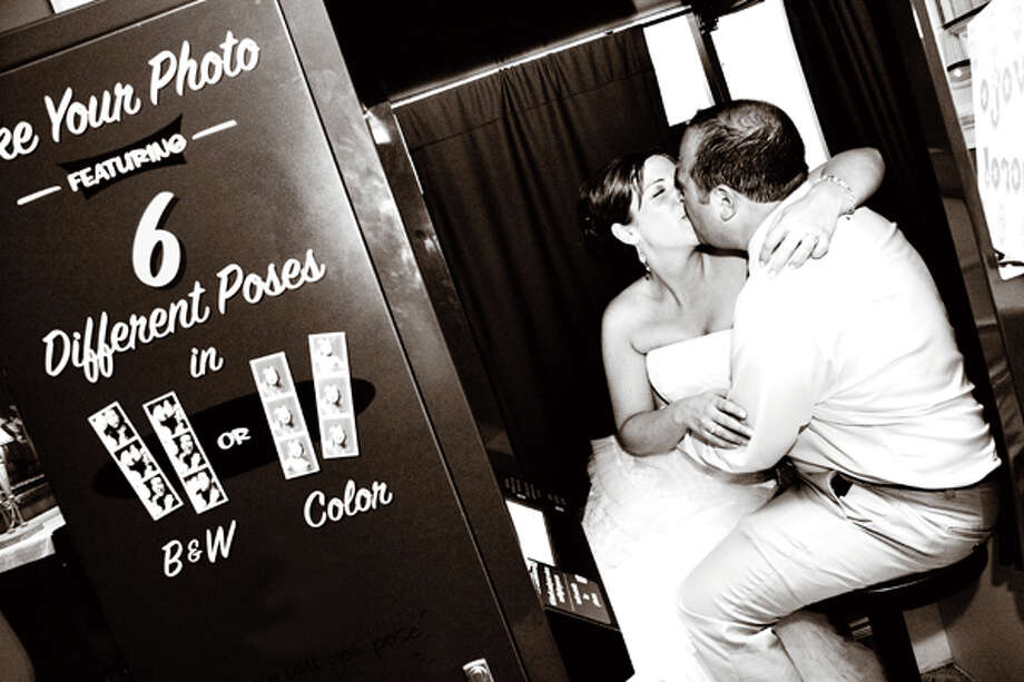 Having a photobooth at your reception can be a big hit for guests. (Photo courtesy of Saratoga Photobooth)