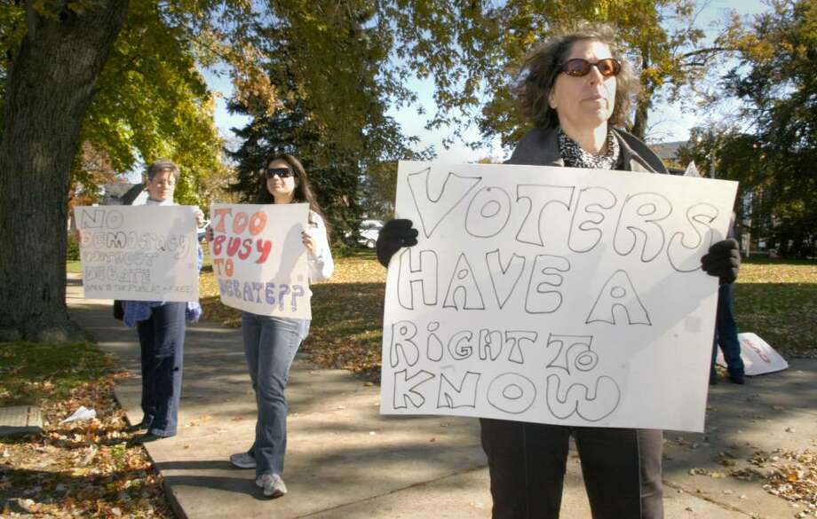 Ellen Dubois, right, is one of the organizors of a protest in front of City Hall in Danbury Monday, October 19, 2009 protesting Mayor Mark Boughton's declining to aattend a debate sponsored by the League of Women Voters. Left to right is , Mary Collins and Rachel DeSousa. Photo: Carol Kaliff / The News-Times