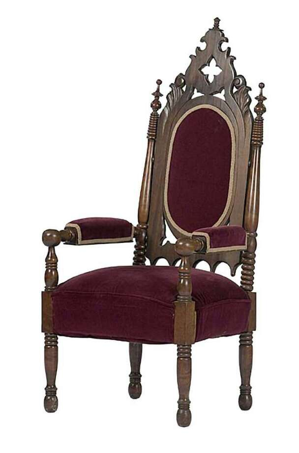 This 51-inch-high Gothic Revival armchair made in the 19th century seems to belong in a dark castle. It was offered for sale last year by Cowanís Auctions of Cincinnati. It looks like a chair owned by one of our readers - a chair thatís supposedly haunted because it ìsqueaksî in the night. Without a ghost, itís worth about $400 to $600. Photo: Contributed Photo