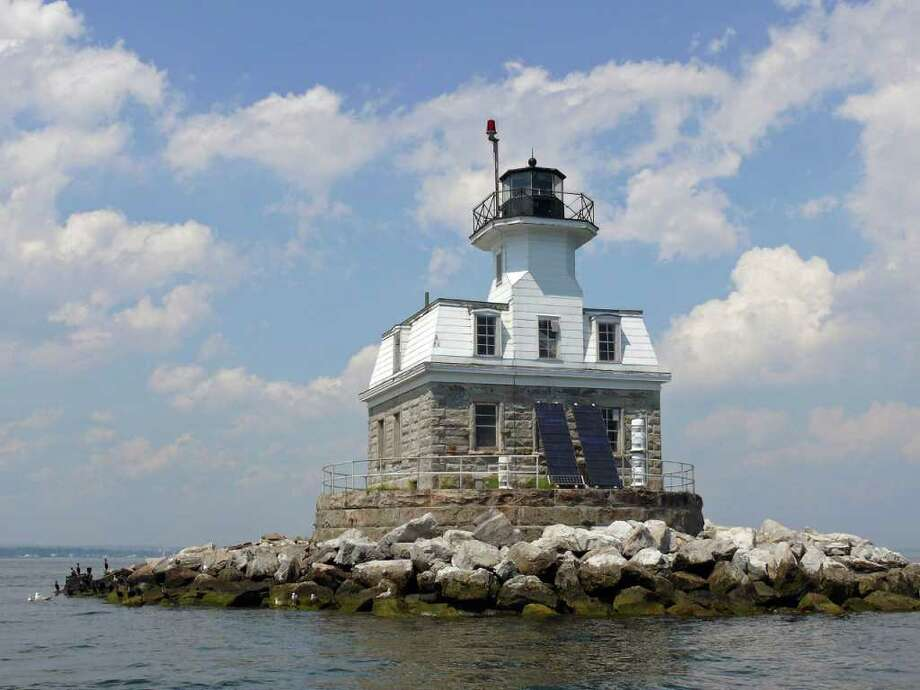 The town hopes it will be able to take possession of the Penfield Reef Lighthouse which has been put on the auction block. The Board of Selectmen approved a $10,000 bid deposit that will be taken from funds raised by the Penfield Lighthouse Committee. Photo: Genevieve Reilly / Fairfield Citizen