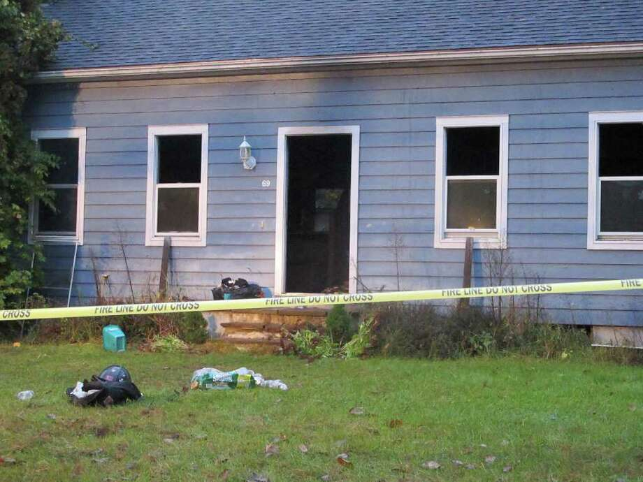 Firefighters managed to knock down a structure fire at a home on Sunny Valley Road in New Milford on Thursday, Oct. 20, 2011. Photo: Libor Jany
