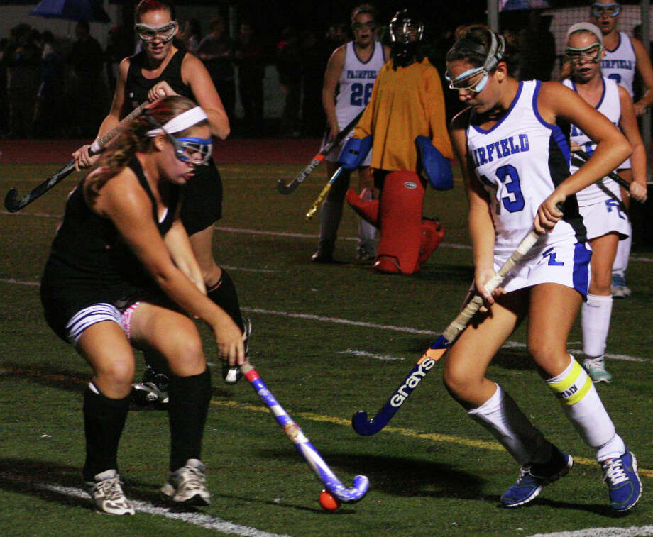 Warde's Erin Hines and Ludlowe's Stephanie Gorab battle for possession during the Falcons' 1-0 win over the Mustangs on Friday night at Taft Field. Photo: Tim Parry