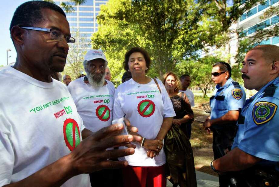From left, Operation People for Peace Facilitator/Chairman Art Rocker stands with Dick Gregory, E. Faye Williams, and Rochelle Brackman as they address security outside of BP's U.S. - based headquarters Thursday, Oct. 20, 2011, in Houston. The group teamed up with Occupy Houston protesters to represent victims of the BP oil spill who seek compensation for their losses. Photo: Cody Duty / © 2011 Houston Chronicle