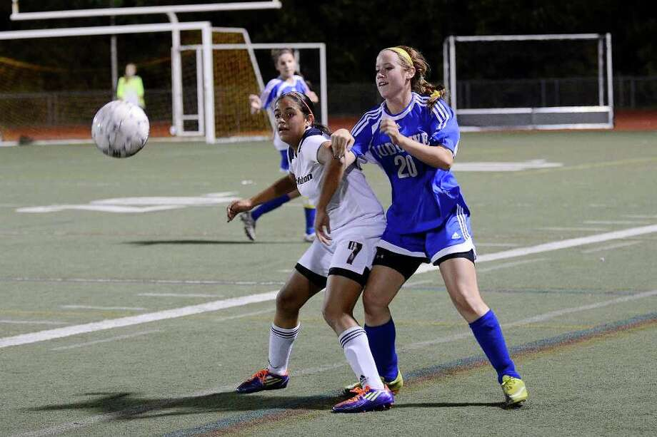 McMahon's #7 Jazmin Hernandez and Ludlowe's #20 Courtney Mazza vie for the ball as Brien McMahon High School hosts Fairfield Ludlowe High School in girls soccer in Stamford, CT on Tues., Oct. 18, 2011. Photo: Shelley Cryan / Shelley Cryan freelance; Stamford Advocate freelance