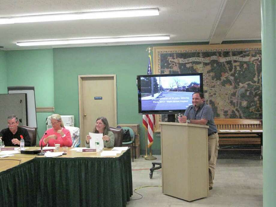 Assistant Director of Public Works Tiger Mann discusses the bids for both the east and west sidewalks of Main Street. Town Council recommended sidewalks for the west side Wednesday night. Photo: Paresh Jha