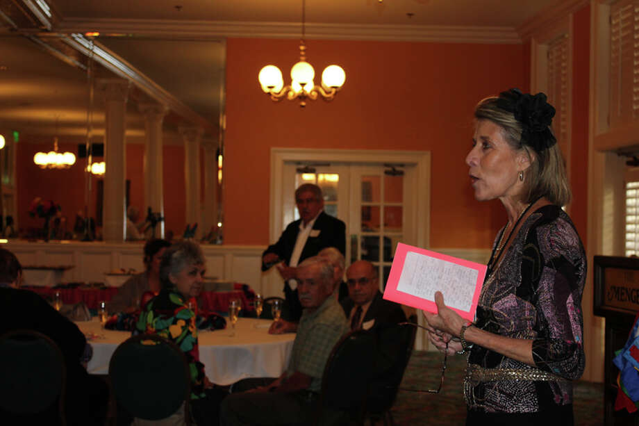 Saundra Paine, director of San Antonio's Pan American Round Table , welcomes the group's members during a gathering Sunday at the Menger Hotel.