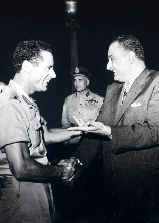 FILE - In this October, 1969 photo, Col. Moammar Gadhafi  , left, appears with Egypt's Prime Minister Gamal Abdel Nasser, right, during his first official visit to Egypt after a military coup in Libya.   A U.S. official says Libya's new government has told the United States that Moammar Gadhafi is dead. The official said Libya's Transitional National Council informed U.S. officials in Libya of the development Thursday, Oct. 20, 2011. Photo: AP