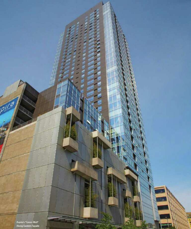 The developers of Aspira, a 37-story, 324-unit apartment building at 1823 Terry Ave., just put the tower up for sale. The tower, completed last year, aims to appeal to young professionals. Photo: Jones Lang LaSalle