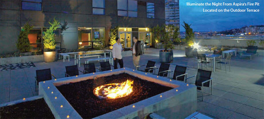 Terrace, with fire pit, of Aspira, a 37-story, 324-unit apartment building at 1823 Terry Ave. The developers just put the tower up for sale. Photo: Jones Lang LaSalle