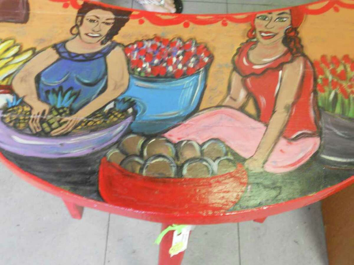Hand-painted table, $85, and Mexican folk art can be found at Artwerx Alley. Photo by Jennifer Rodriguez/Special to the Express-News