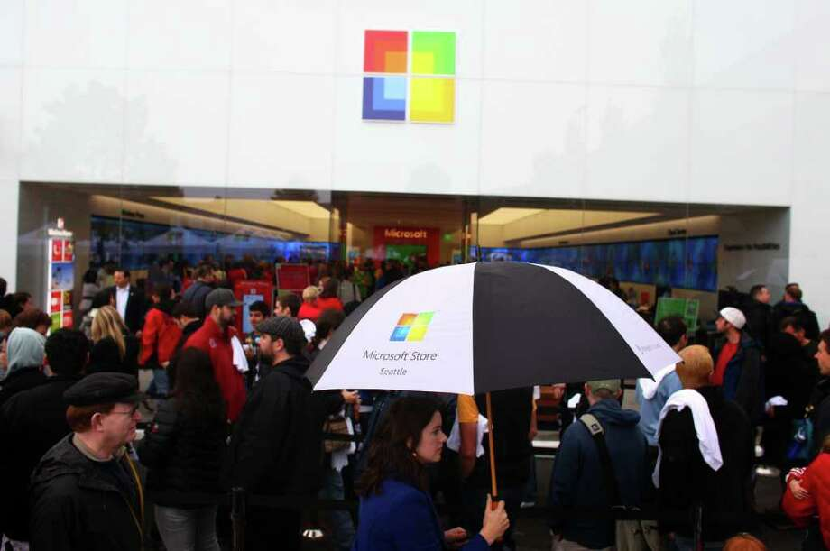 People wait in line at the grand opening of the Microsoft Store at University Village on Thursday, October 20, 2011. Photo: JOSHUA TRUJILLO / SEATTLEPI.COM