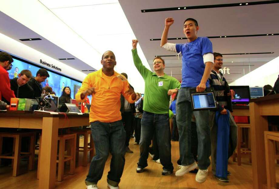 Microsoft Store employees cheer as customers begin to stream into the new retail store during its grand opening at University Village on Thursday, October 20, 2011. Photo: JOSHUA TRUJILLO / SEATTLEPI.COM