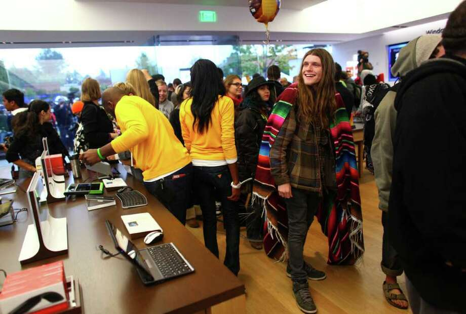 People wander the store during the grand opening of the Microsoft Store at University Village on Thursday, October 20, 2011. Photo: JOSHUA TRUJILLO / SEATTLEPI.COM