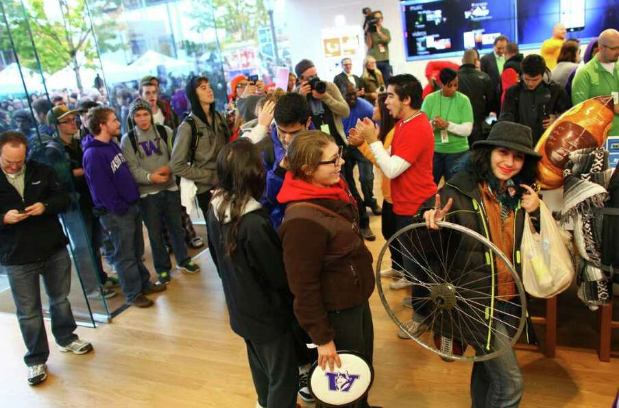 People wander the store during the grand opening of the Microsoft Store at University Village on Thu