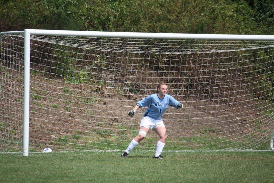 Weston's Maggie Maretz awaits a shot in warmups. Maretz made 12 saves in the last two games. Photo: Contributed Photo