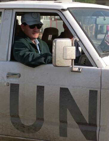 Arms inspector Scott Ritter is driven in a U.N. truck toward the airport in Baghdad in this December 23, 1997, photo. (AP Photo Archive/Jassim Mohammed) Photo: JASSIM MOHAMMED / AP