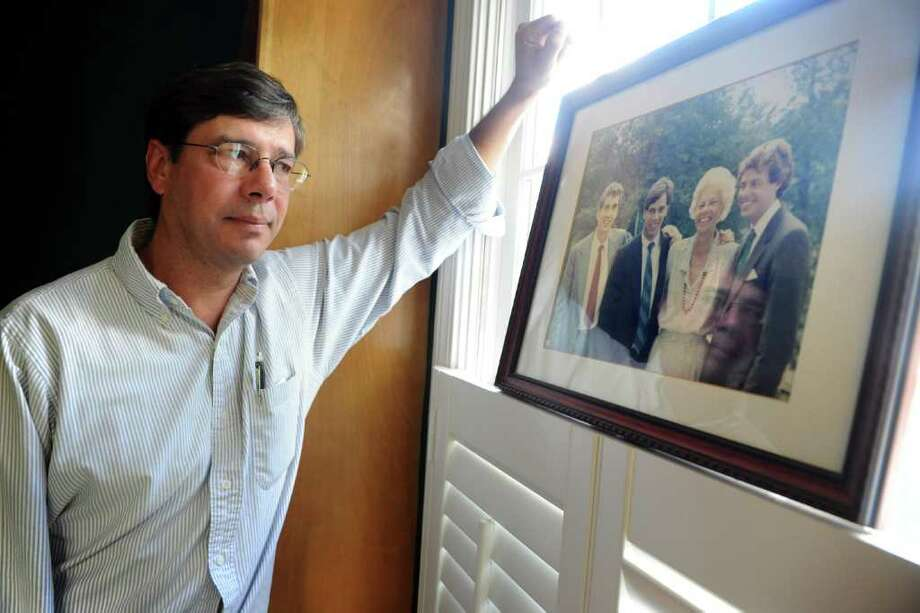 Paul Zwynenburg, at his home in Fairfield, Conn. Thursday, Oct. 20, 2011, looks at the last photo taken with his family intact.  His brother, Mark Zwynenburg, far right, was killed in 1988 when his Pan Am flight 103 was blown up over Lockerbie, Scotland. Photo: Autumn Driscoll