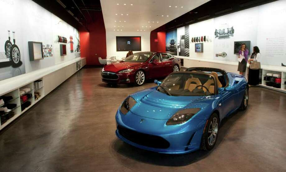 The Tesla Gallery in the Galleria is shown Thursday, Oct. 20, 2011, in Houston. Electric cars made by Tesla are the main attractions in the gallery. Photo: Brett Coomer, Houston Chronicle / © 2011 Houston Chronicle