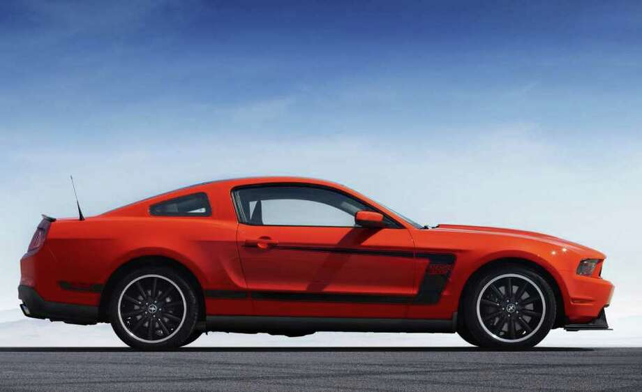 "The Boss 302 has special wheels and an exterior paint scheme that includes either a black or white top and matching side ""C"" stripes. COURTESY OF FORD MOTOR CO. Photo: Ford Motor Co., COURTESY OF FORD MOTOR CO."