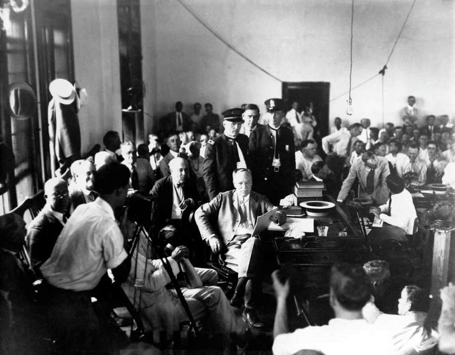 ** FOR IMMEDIATE RELEASE--FILE **Judge John T. Raulston of Winchester, Tenn., center, holds the decision in the Tennessee vs. John Scopes case at the Rhea County Courthouse in Dayton, Tenn., in this July 17, 1925, file photo. Scopes, a high school biology teacher, was on trial for violating the Butler Act, a Tennessee law that forbids the teaching of the theory of evolution in public schools. The courthouse and museum now located in the basement, may be one of about 20 possible stops in a 10-county area that would be part of a religious heritage trail in southeast Tennessee.  (AP Photo/FILE) / AP
